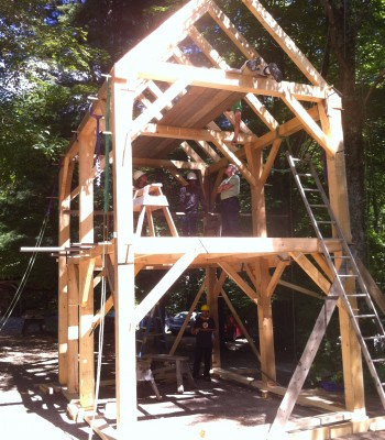 Front view of two-story timber frame.