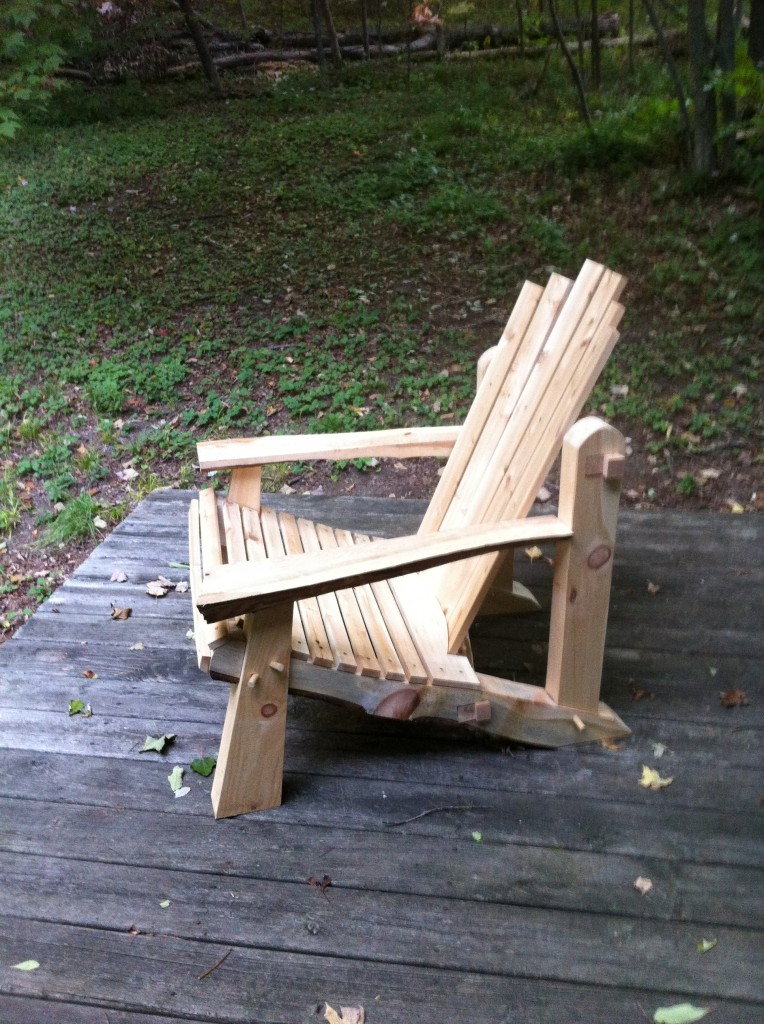 Profile of adirondack chair. The chair resides on the back porch at Heartwood.