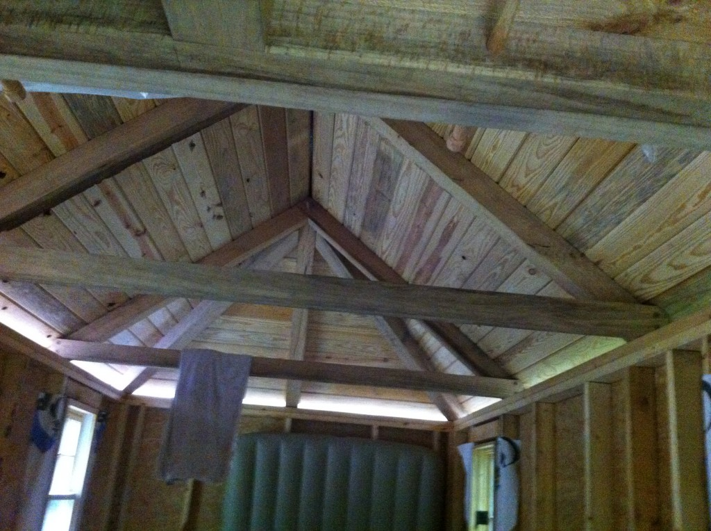 Inside of tiny home looking at the timber-framed hipped roof (9.5/12 pitch was tricky). Although the house isn't quite done, the owner already moved in with his kids.
